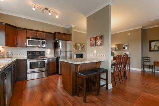 """Photo 7: 408 20286 53A Avenue in Langley: Langley City Condo for sale in """"CASA VERONA"""" : MLS®# R2177236"""