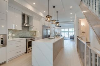 Photo 11: 244 21 Avenue NW in Calgary: Tuxedo Park Detached for sale : MLS®# A1016245