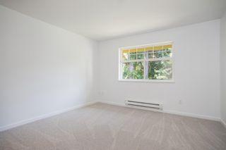 "Photo 9: 14 15518 103A Avenue in Surrey: Guildford Townhouse for sale in ""CEDAR LANE"" (North Surrey)  : MLS®# R2612292"