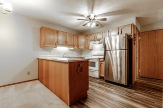 Photo 5: 10 Sandarac Circle NW in Calgary: Sandstone Valley Row/Townhouse for sale : MLS®# A1145487
