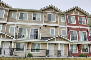 Photo 2: 63 Redstone Circle NE in Calgary: Redstone Row/Townhouse for sale : MLS®# A1141777