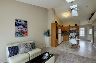 Photo 8: 8 12 Woodside Rise NW: Airdrie Row/Townhouse for sale : MLS®# A1108776