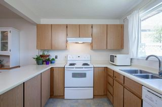 Photo 20: 332 Queenston Heights SE in Calgary: Queensland Row/Townhouse for sale : MLS®# A1114442