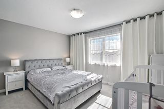 Photo 29: 504 281 Cougar Ridge Drive SW in Calgary: Cougar Ridge Row/Townhouse for sale : MLS®# A1123514