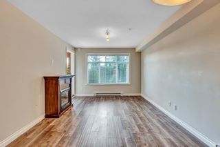"Photo 7: 112 5650 201A Street in Langley: Langley City Condo for sale in ""Paddington Station"" : MLS®# R2548743"