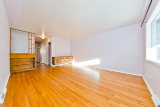 Photo 7: 1028 / 1026 39 Avenue NW in Calgary: Cambrian Heights Duplex for sale : MLS®# A1050074