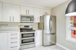 Photo 6: 215 Strathearn Crescent SW in Calgary: Strathcona Park Detached for sale : MLS®# A1146284
