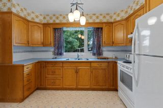 Photo 10: 21 Cadogan Road NW in Calgary: Cambrian Heights Detached for sale : MLS®# A1138716