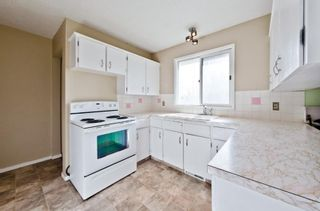 Photo 5: 539 HUNTERPLAIN Hill NW in Calgary: Huntington Hills Detached for sale : MLS®# A1024979