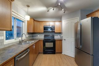 Photo 12: 704 Luxstone Square SW: Airdrie Detached for sale : MLS®# A1133096