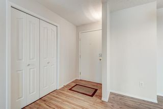Photo 2: 1306 604 8 Street SW: Airdrie Apartment for sale : MLS®# A1066668