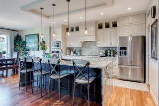 Photo 19: 168 ASCOT CR SW in Calgary: Aspen Woods House for sale : MLS®# C4268023