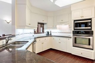 Photo 19: 217 Signature Way SW in Calgary: Signal Hill Detached for sale : MLS®# A1148692