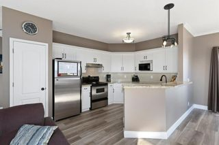 Photo 9: 82 Prestwick Gardens SE in Calgary: McKenzie Towne Row/Townhouse for sale : MLS®# A1079560