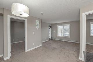 Photo 3: 413 7130 80 Avenue NE in Calgary: Saddle Ridge Apartment for sale : MLS®# A1144458
