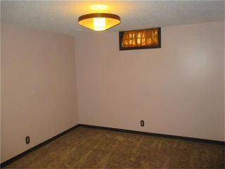 Photo 16: 5735 LADBROOKE Drive SW in Calgary: Lakeview House for sale : MLS®# C4031182