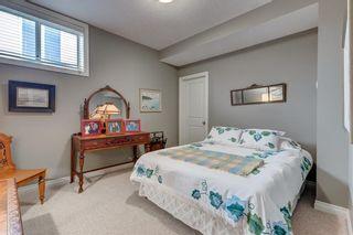 Photo 31: 206 GLENEAGLES View: Cochrane House for sale : MLS®# C4181281