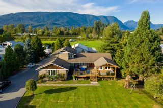 Photo 1: 18949 MCQUARRIE Road in Pitt Meadows: North Meadows PI House for sale : MLS®# R2620958