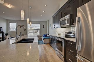 Photo 4: 42 248 Kinniburgh Boulevard: Chestermere Row/Townhouse for sale : MLS®# A1093515