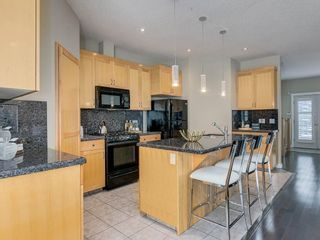 Photo 11: 81 Somme Boulevard SW in Calgary: Garrison Woods Residential for sale : MLS®# A1072185