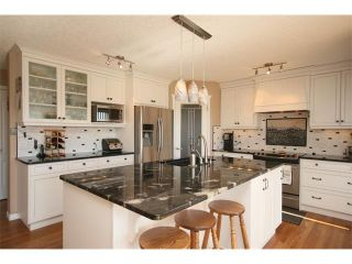 Photo 16: 51 GLENEAGLES View: Cochrane House for sale : MLS®# C4008842