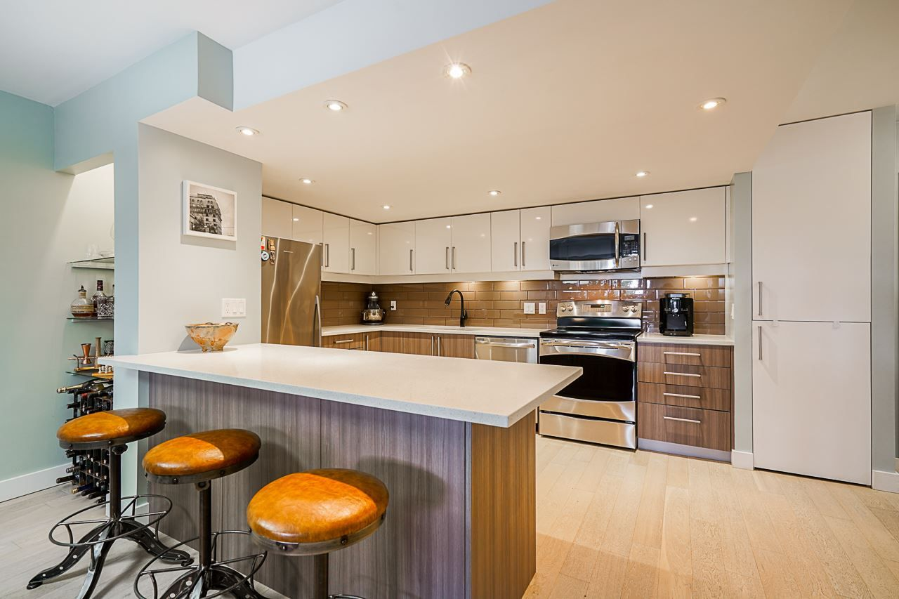 """Main Photo: 102 1450 PENNYFARTHING Drive in Vancouver: False Creek Condo for sale in """"Harbour Cove"""" (Vancouver West)  : MLS®# R2560607"""