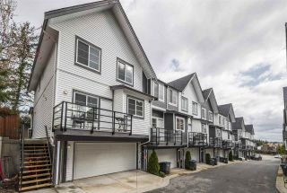 """Photo 1: 10 6767 196 Street in Surrey: Clayton Townhouse for sale in """"Clayton Creek"""" (Cloverdale)  : MLS®# R2555935"""