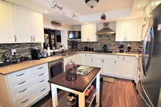 Photo 4: 14 448 Strathcona Drive SW in Calgary: Strathcona Park Row/Townhouse for sale : MLS®# A1062533