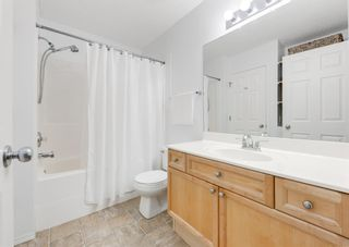 Photo 25: 218 950 ARBOUR LAKE Road NW in Calgary: Arbour Lake Row/Townhouse for sale : MLS®# A1136377