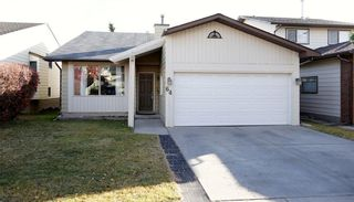Photo 1: 64 STRATHCONA Close SW in Calgary: Strathcona Park House for sale : MLS®# C4142880