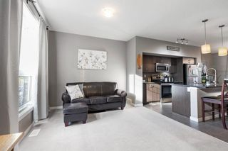 Photo 4: 304 Cranfield Common SE in Calgary: Cranston Row/Townhouse for sale : MLS®# A1154172