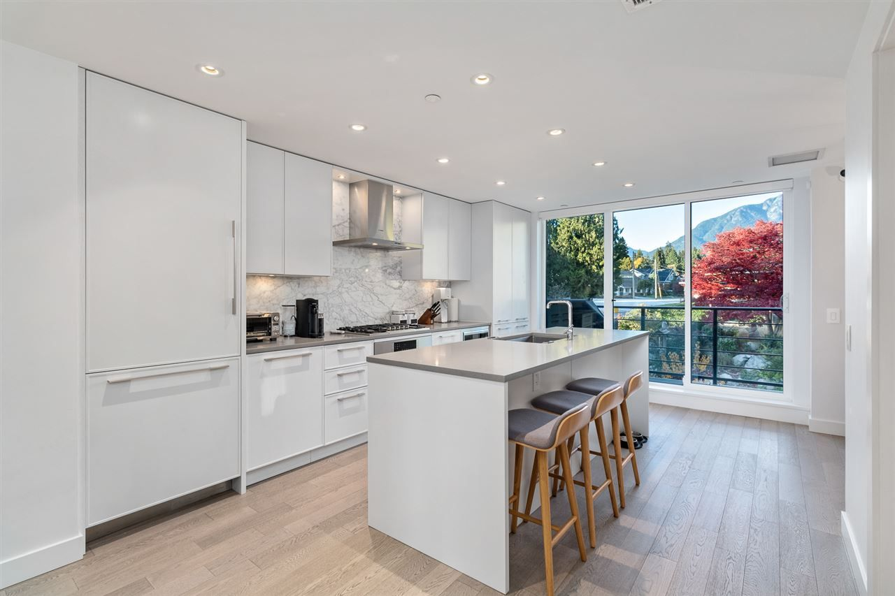 """Main Photo: 209 1055 RIDGEWOOD Drive in North Vancouver: Edgemont Townhouse for sale in """"CONNAUGHT"""" : MLS®# R2533601"""