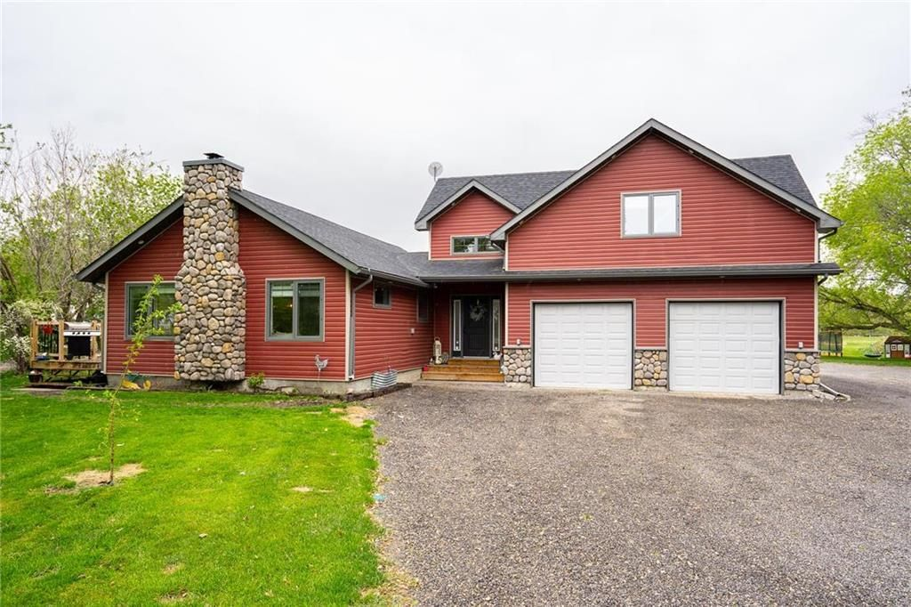 Main Photo: 1235 BREEZY POINT Road in St Andrews: R13 Residential for sale : MLS®# 202112423