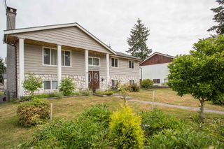 Photo 2: 809 RUNNYMEDE Avenue in Coquitlam: Coquitlam West House for sale : MLS®# R2600920