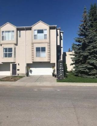 Main Photo: 2401 17 Street SW in Calgary: Bankview Row/Townhouse for sale : MLS®# A1087305