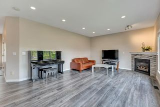 Photo 5: 37 1751 PADDOCK Drive in Coquitlam: Westwood Plateau Townhouse for sale : MLS®# R2579249