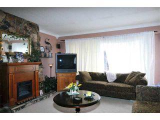 Photo 3: 617 LEA Avenue in Coquitlam: Coquitlam West Duplex for sale : MLS®# V968344
