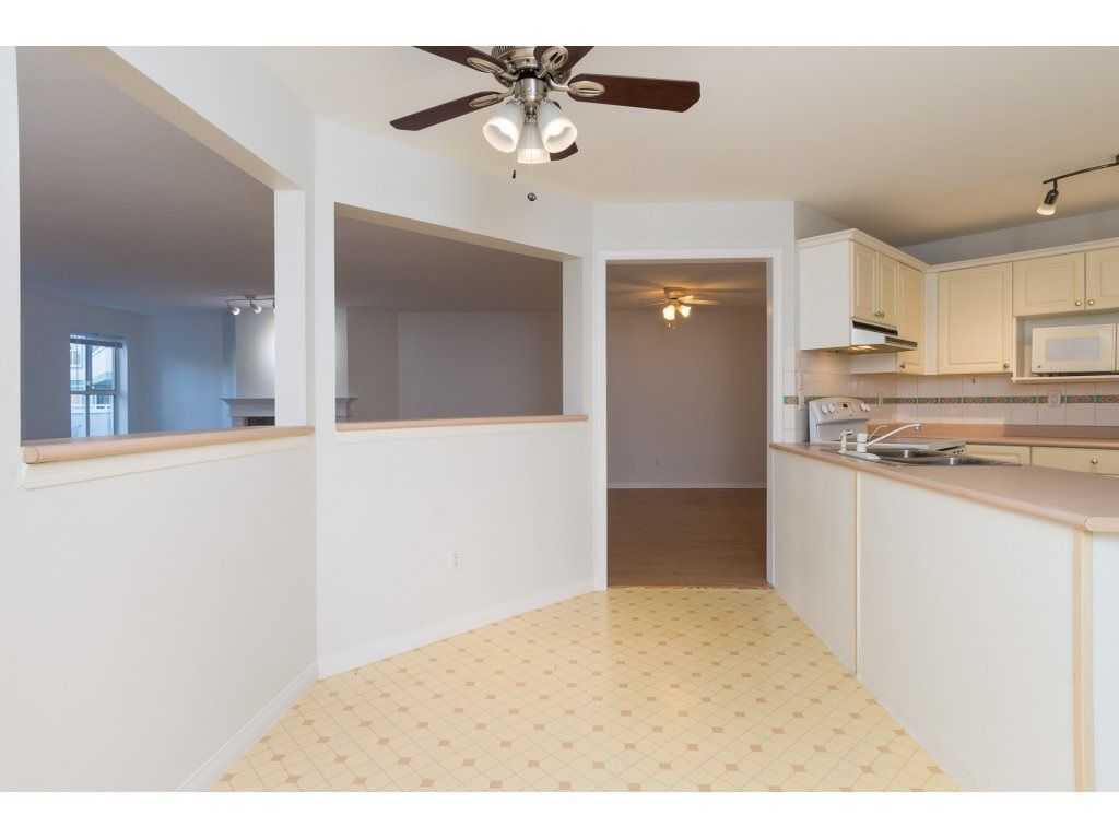 "Photo 8: Photos: 211 12633 72 Avenue in Surrey: West Newton Condo for sale in ""College Park"" : MLS®# R2226813"