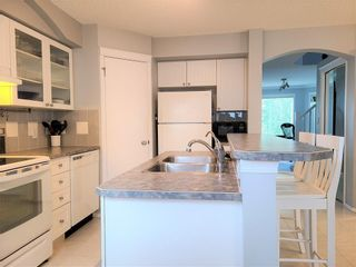 Photo 8: 12 TUSCANY SPRINGS Park NW in Calgary: Tuscany Detached for sale : MLS®# C4300407