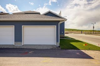 Photo 35: 108 Creekside Drive SW in Calgary: C-168 Semi Detached for sale : MLS®# A1062823