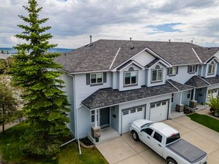 Photo 4: 112 Rocky Vista Circle NW in Calgary: Rocky Ridge Row/Townhouse for sale : MLS®# A1125808