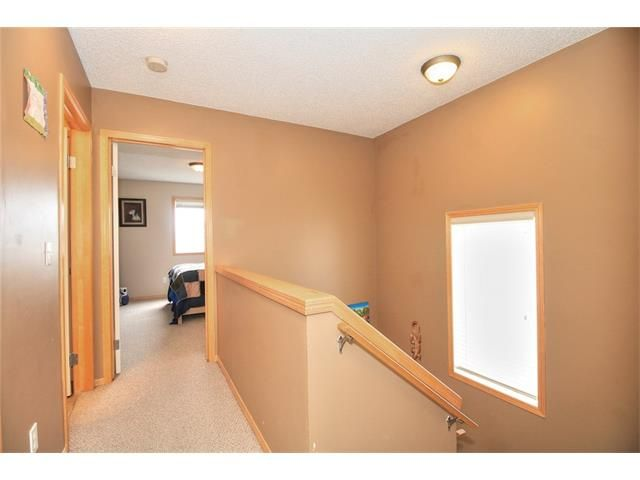 Photo 20: Photos: 304 EVERSYDE Circle SW in Calgary: Evergreen House for sale : MLS®# C4035934