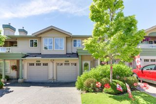 """Photo 1: 129 13888 70TH Avenue in Surrey: East Newton Townhouse for sale in """"Chelsea Gardens"""" : MLS®# R2594472"""