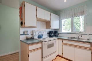 Photo 8: 5407 LADBROOKE Drive SW in Calgary: Lakeview Detached for sale : MLS®# A1009726