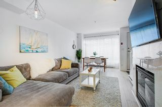 """Photo 3: 2110 YEW Street in Vancouver: Kitsilano Townhouse for sale in """"Magnolia Gardens"""" (Vancouver West)  : MLS®# R2348200"""