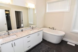 Photo 33: 207 20 Brentwood Common NW in Calgary: Brentwood Row/Townhouse for sale : MLS®# A1143237