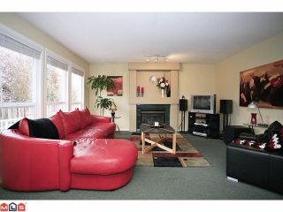"""Photo 2: 18127 68TH Avenue in Surrey: Cloverdale BC House for sale in """"Cloverwoods"""" (Cloverdale)  : MLS®# F1111652"""