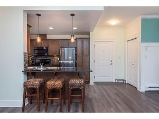 """Photo 12: 106 2068 SANDALWOOD Crescent in Abbotsford: Central Abbotsford Condo for sale in """"The Sterling"""" : MLS®# R2590932"""