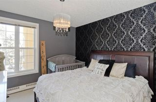 Photo 18: 209 208 HOLY CROSS Lane SW in Calgary: Mission Condo for sale : MLS®# C4113937