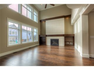 Photo 3: 720 COMO LAKE Avenue in Coquitlam: Coquitlam West House for sale : MLS®# V1072916
